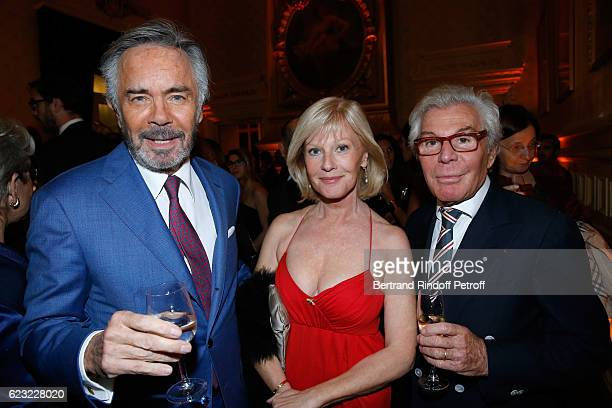 Actress Elisa Servier standing between her companion Pascal Cromback and JeanDaniel Lorieux attend the 24th Gala de l'Espoir at Theatre du Chatelet...