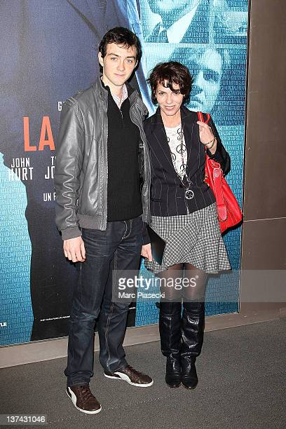 Actress Elisabeth Bourgine and her son Jules attend the 'Tinker Tailor Soldier Spy' photocall on January 20 2012 in Paris France
