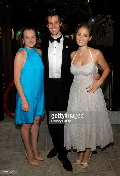 Actress Elisabeth Moss actor Jason Dohring and actress Erika Christensen pose during the 39th annual Church of Scientology anniversary gala held at...