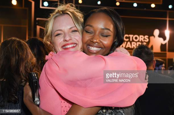 US actress Elisabeth Moss and actress Ashleigh LaThrop hug during the 26th Annual Screen Actors Guild Awards show at the Shrine Auditorium in Los...