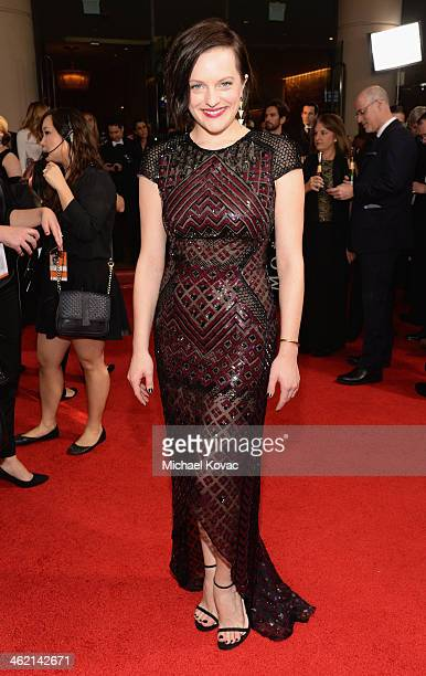 Actress Elisabeth Moss attends the 71st Annual Golden Globe Awards with Moet Chandon held at the Beverly Hilton Hotel on January 12 2014 in Los...