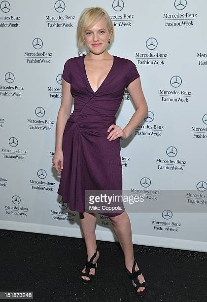 Actress Elisabeth Moss poses backstage at the J Mendel Spring 2013 fashion show during MercedesBenz Fashion Week at The Theatre Lincoln Center on...