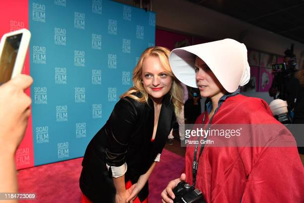 Actress Elisabeth Moss poses with a festival goer during 22nd SCAD Savannah Film Festival on October 31, 2019 at Trustees Theater in Savannah,...