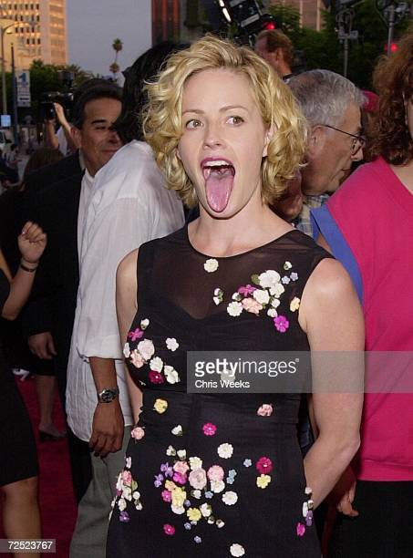 Actress Elisabeth Shue sticks her tongue out for photographers at the premiere of her new film Hollow Man August 2 2000 in Westwood CA