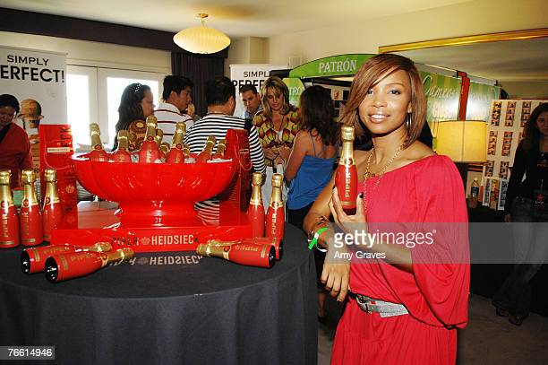 Actress Elise Neal holds a bottle of Piper Heidsieck champagne at the Star Lounge In Honor of Rolling Stone's 40th Anniversary at the Hard Rock Hotel...