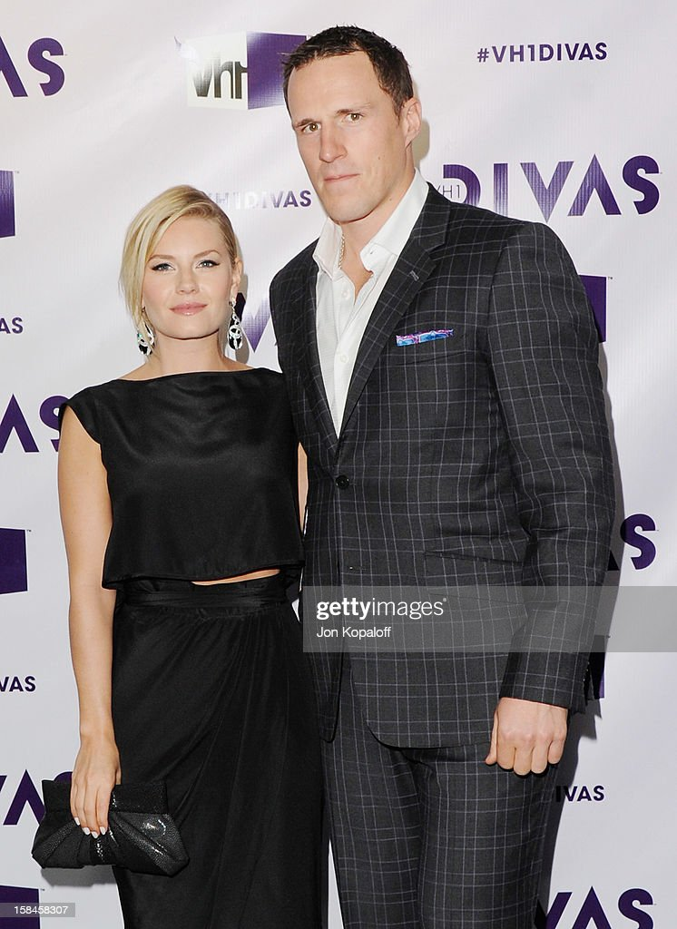 Actress Elisha Cuthbert and fiance Dion Phaneuf arrive at the 'VH1 Divas' 2012 at The Shrine Auditorium on December 16, 2012 in Los Angeles, California.