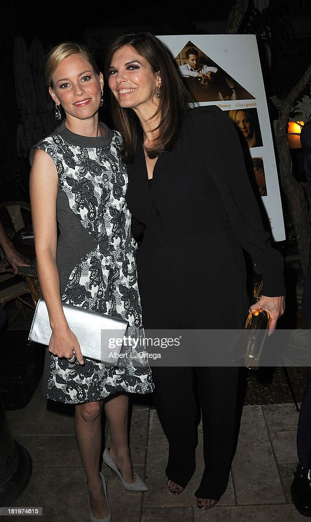 Actress Elizabeth Banks and actress Jeanne Tripplehorn attend C Magazine Dinner And Reception Celebrating Leland Orser's 'Morning' held at Chateau Marmont on September 26, 2013 in West Hollywood, California.