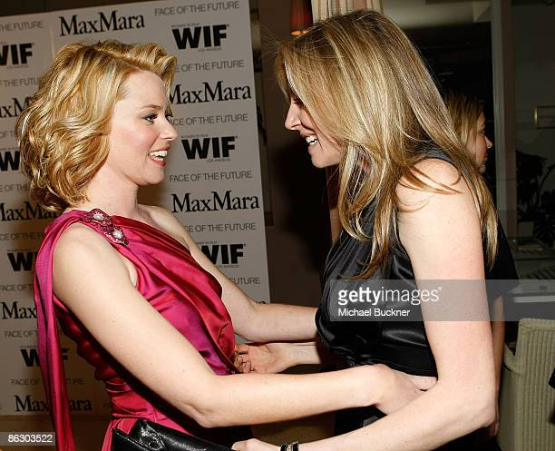 Actress Elizabeth Banks and actress Sarah Chalke attend the Women in Film MaxMara Face of the Future 2009 Cocktail Party at the Sunset Tower Hotel on...