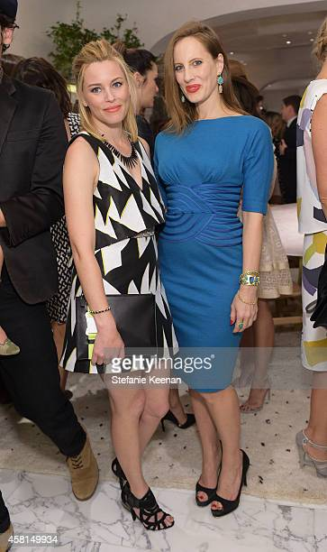 Actress Elizabeth Banks and Liz Goldwyn attends the Irene Neuwirth Flagship Grand Opening on October 30 2014 in West Hollywood California