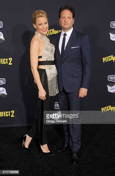 Actress Elizabeth Banks and Max Handelman arrive at the Los Angeles premiere of Pitch Perfect 2 at Nokia Theatre LA Live on May 8 2015 in Los Angeles...