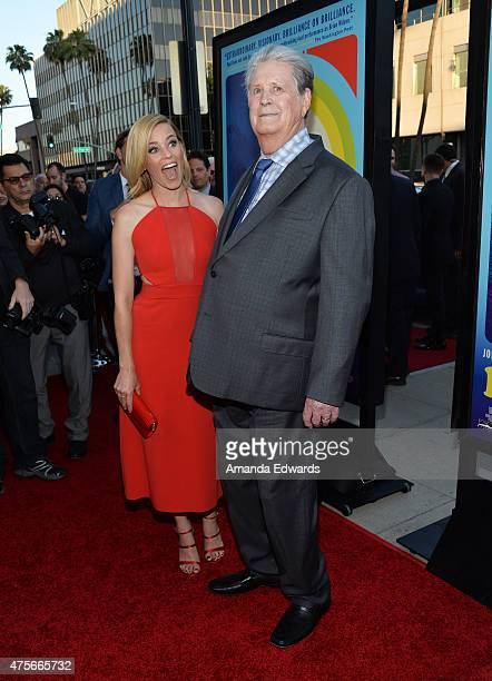 Actress Elizabeth Banks and musician Brian Wilson arrive at the 'Love Mercy' Los Angeles premiere at the Samuel Goldwyn Theater on June 2 2015 in...