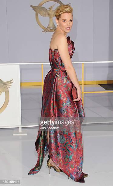 Actress Elizabeth Banks arrives at the Los Angele Premiere The Hunger Games Mockingjay Part 1 at Nokia Theatre LA Live on November 17 2014 in Los...