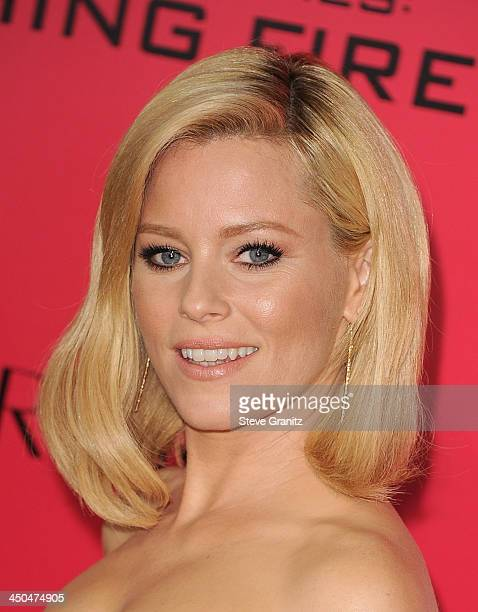 Actress Elizabeth Banks arrives at the Los Angeles premiere of The Hunger Games Catching Fire at Nokia Theatre LA Live on November 18 2013 in Los...