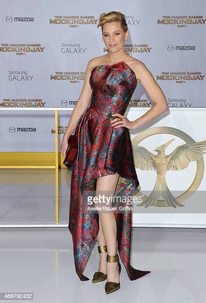 Actress Elizabeth Banks arrives at the Los Angeles premiere of 'The Hunger Games Mockingjay Part 1' at Nokia Theatre LA Live on November 17 2014 in...