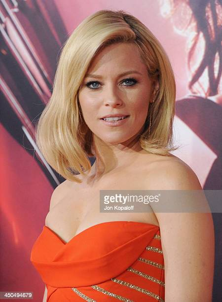 Actress Elizabeth Banks arrives at the Los Angeles Premiere The Hunger Games Catching Fire at Nokia Theatre LA Live on November 18 2013 in Los...