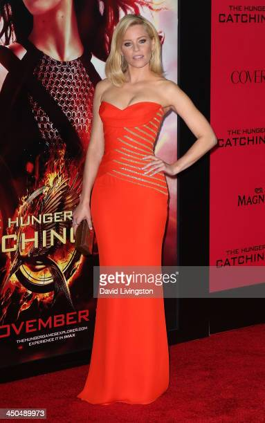 Actress Elizabeth Banks attends the premiere of Lionsgate's The Hunger Games Catching Fire at Nokia Theatre LA Live on November 18 2013 in Los...