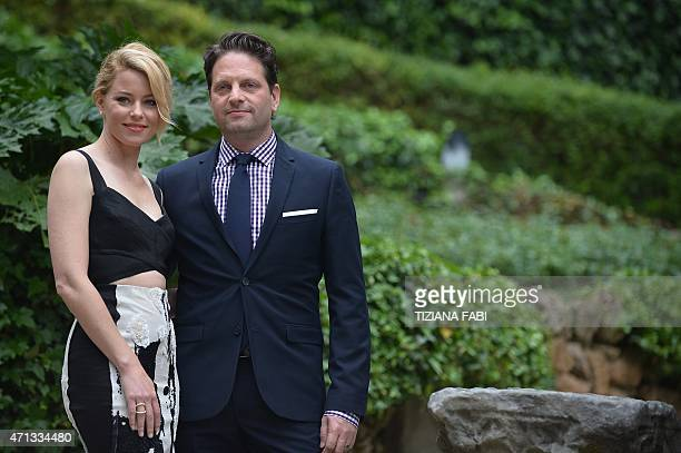 US actress Elizabeth Banks poses with her husband US film producer Max Handelman during a photocall of the film Pitch Perfect 2 in Rome on April 27...