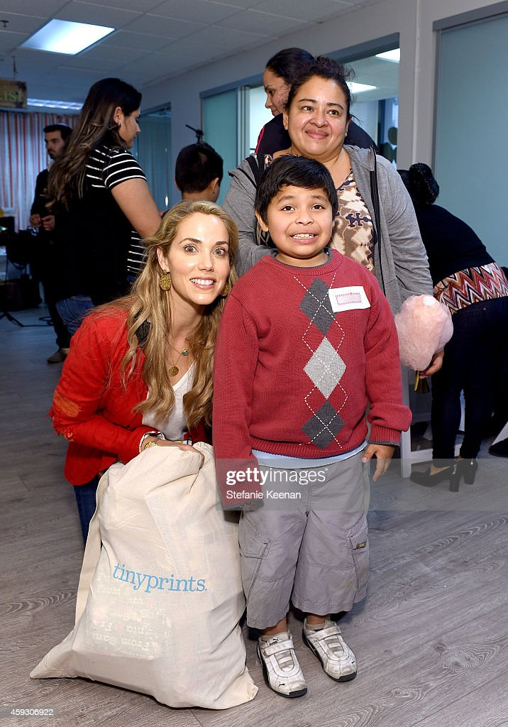 Actress Elizabeth Berkley attends the Baby2Baby Nutcracker Party, Presented By Tiny Prints on November 20, 2014 in Los Angeles, California.