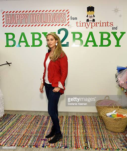 Actress Elizabeth Berkley attends the Baby2Baby Nutcracker Party Presented By Tiny Prints on November 20 2014 in Los Angeles California