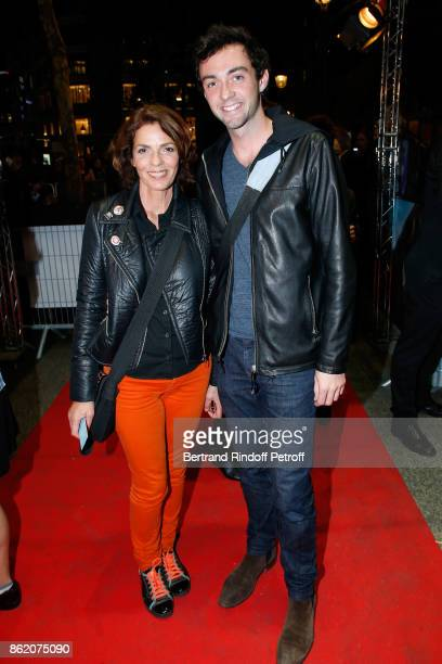 Actress Elizabeth Bourgine and her son Jules attend the Knock Paris Premiere at Cinema UGC Normandie on October 16 2017 in Paris France
