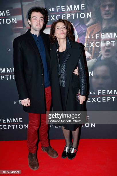 Actress Elizabeth Bourgine and her son Jules Miesch attend the Une Femme d'Exception On the Basis of Sex Paris Premiere at Cinema Gaumont Capucine on...