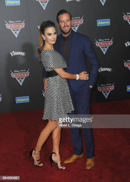 Actress Elizabeth Chambers and actor Armie Hammer arrive for the Premiere Of Disney And Pixar's Cars 3 held at Anaheim Convention Center on June 10...