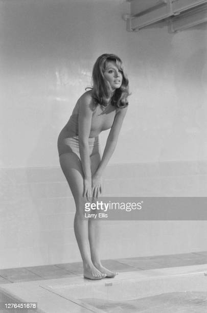 Actress Elizabeth Ercy filming a swimming pool scene for the comedy 'Doctor In Clover' UK 21st October 1965