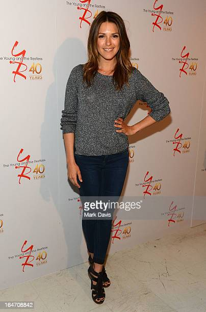 Actress Elizabeth Hendrickson poses at 'The Young The Restless' 40th anniversary cakecutting ceremony at CBS Television City on March 26 2013 in Los...