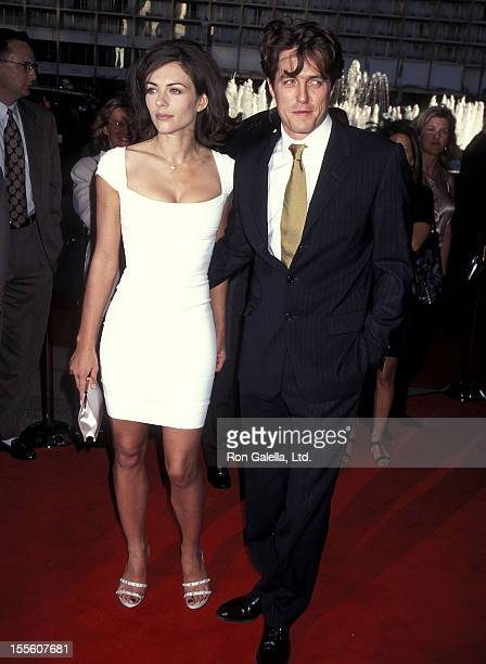 "Actress Elizabeth Hurley and actor Hugh Grant attends the ""Nine Months"" Century City Premiere on July 11, 1995 at Cineplex Odeon Century Plaza..."