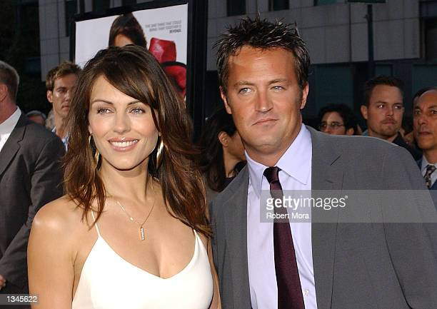 "Actress Elizabeth Hurley and actor Matthew Perry attend the premiere of ""Serving Sara"" at the Samuel Goldwyn Theater on August 20, 2002 in Beverly..."