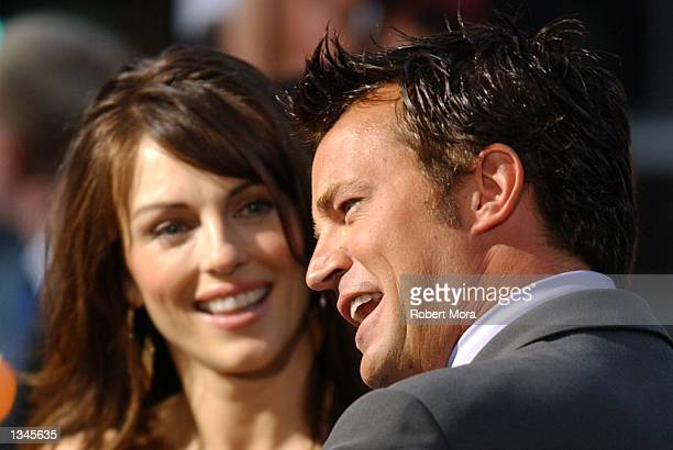 Actress Elizabeth Hurley and actor Matthew Perry attend the premiere of Serving Sara at the Samuel Goldwyn Theater on August 20 2002 in Beverly Hills...