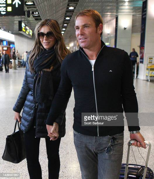 Actress Elizabeth Hurley and fiancee former Australian cricket player Shane Warne arrive at Melbourne Airport on May 3 2012 in Melbourne Australia