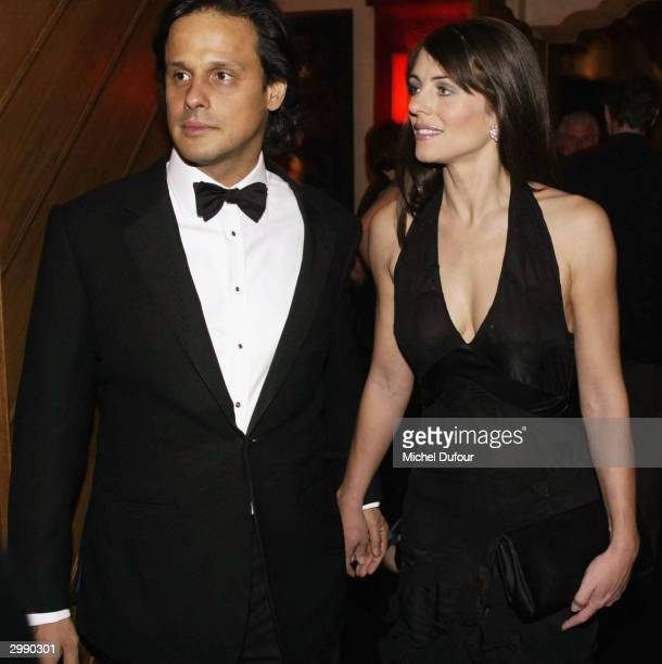 Actress Elizabeth Hurley and her boyfriend Arun Nayar attend the unveiling of De Grisogono new high jewellery collection on February 16 2004 in the...