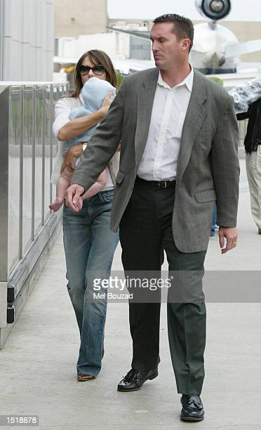 Actress Elizabeth Hurley arrives at Los Angeles airport with her son Damian and a bodyguard October 24 2002 in Los Angeles California