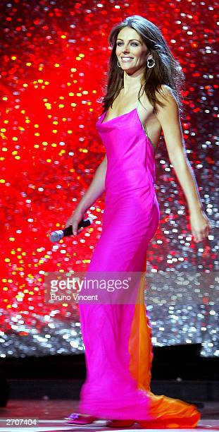 Actress Elizabeth Hurley hosts Fashion Rocks for the Princes Trust at the Royal Albert Hall October 15 2003 in London wearing a gown by Ralph Lauren...