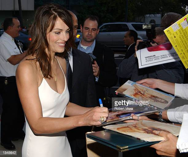 "Actress Elizabeth Hurley signs autographs prior to the premiere of ""Serving Sara"" at the Samuel Goldwyn Theater on August 20, 2002 in Beverly Hills,..."