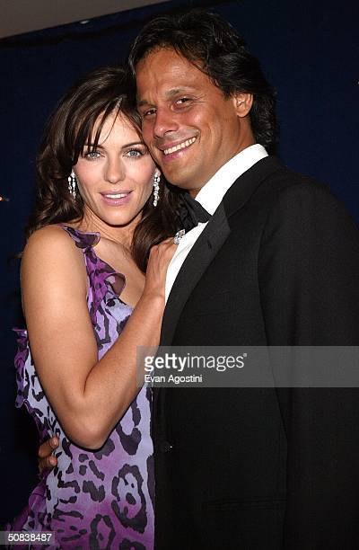 Actress Elizabeth Hurley wearing Chopard jewelry and her boyfriend Arun Nayar attends The Chopard Trophy party at Palm Beach May 14 2004 in Cannes...