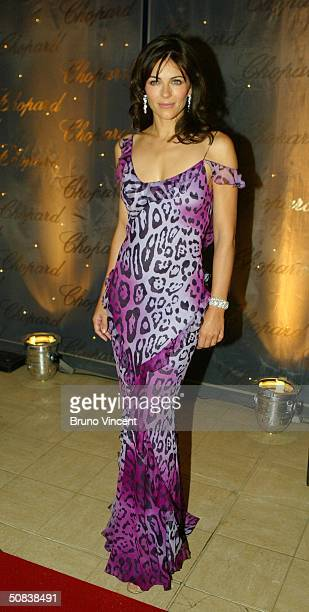 Actress Elizabeth Hurley wearing Chopard jewelry attends The Chopard Trophy party at Palm Beach on May 14 2004 in Cannes France The party is...