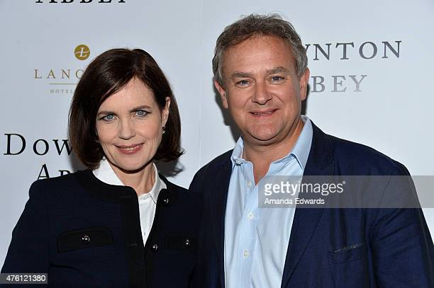 Actress Elizabeth McGovern and actor Hugh Bonneville arrive at the Afternoon With 'Downton Abbey' Talent Panel at the Writers Guild Theater on June 6...
