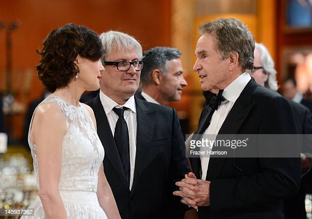 Actress Elizabeth McGovern filmmaker Simon Curtis and actor Warren Beatty attend the 40th AFI Life Achievement Award honoring Shirley MacLaine held...