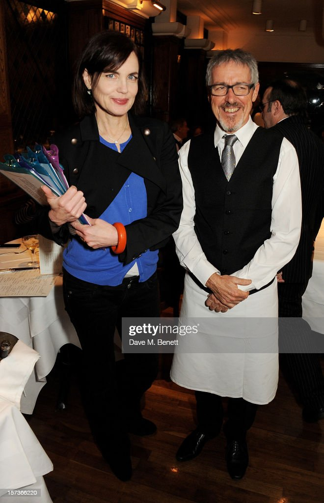 Actress Elizabeth McGovern (L), working as a hostess, and Griff Rhys Jones, working as a waiter, attend One Night Only at The Ivy, featuring 30 stage and screen actors working as staff during dinner at The Ivy, in aid of The Combined Theatrical Charities, on December 2, 2012 in London, England.