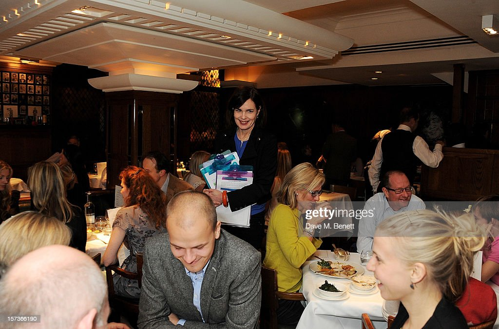 Actress Elizabeth McGovern, working as a hostess, attends One Night Only at The Ivy, featuring 30 stage and screen actors working as staff during dinner at The Ivy, in aid of The Combined Theatrical Charities, on December 2, 2012 in London, England.