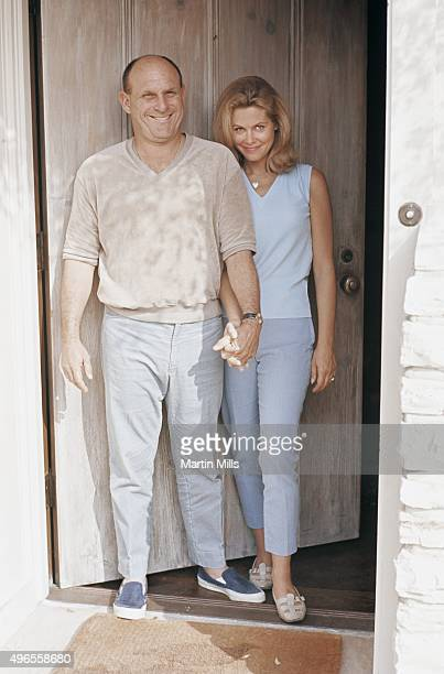 Actress Elizabeth Montgomery and her husband producer and director Bill Asher pose for a portrait at home in 1966 in Beverly Hills California