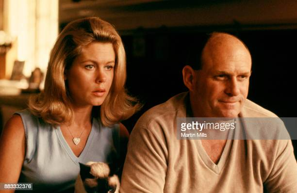 Actress Elizabeth Montgomery and her husband producer and director William Asher pose for a portrait at home circa 1966 in Beverly Hills California