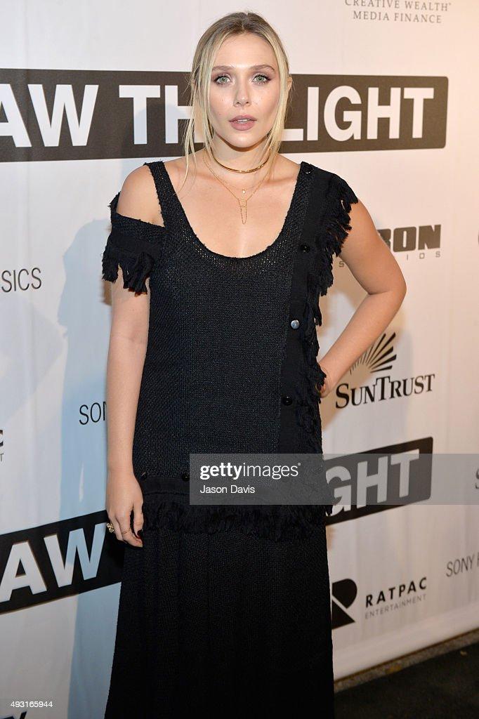 Actress Elizabeth Olsen arrives at the 'I Saw The Light' Nashville Premier at The Belcourt Theatre on October 17, 2015 in Nashville, Tennessee.
