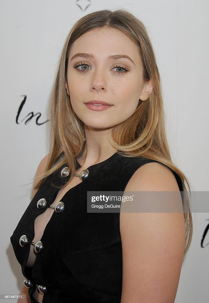 Actress Elizabeth Olsen arrives at the Los Angeles premiere of 'In Secret' at ArcLight Hollywood on February 6, 2014 in Hollywood, California.