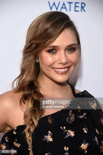 Actress Elizabeth Olsen arrives at the premiere of The Weinstein Company's 'Wind River' at The Theatre at Ace Hotel on July 26 2017 in Los Angeles...