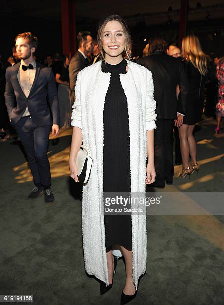 Actress Elizabeth Olsen attends the 2016 LACMA Art Film Gala Honoring Robert Irwin and Kathryn Bigelow Presented By Gucci at LACMA on October 29 2016...