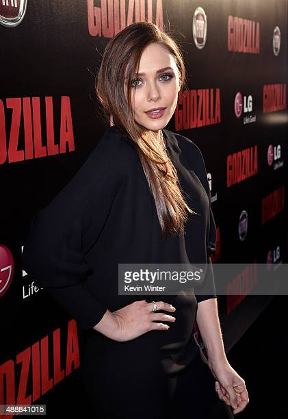 Actress Elizabeth Olsen attends the premiere of Warner Bros Pictures and Legendary Pictures' Godzilla at Dolby Theatre on May 8 2014 in Hollywood...