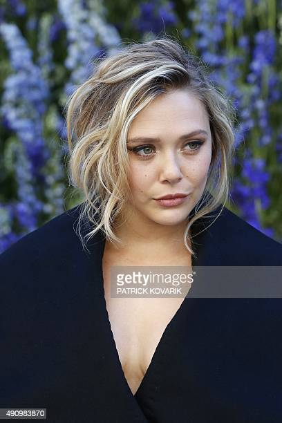 US actress Elizabeth Olsen poses prior to the start of the Christian Dior 2016 Spring/Summer readytowear collection fashion show on October 2 2015 in...